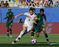 GRENOBLE, FRANCE - JUNE 22: Lena Oberdorf #6 dribbles as Halimatu Ayinde #18 closes during a game between Panama and Guyana at Stade des Alpes on June 22, 2019 in Grenoble, France.