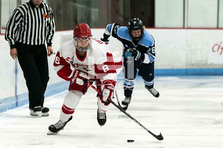 BOSTON, MA - JANUARY 04: Deziray De Sousa #8 of Boston University looks to pass during a game between University of Maine and Boston University at Walter Brown Arena on January 04, 2020 in Boston, Massachusetts.