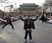 "Crazy Chef (dreadlocked), Kirby Lee (with spectacles) and J-fever (the thinnest), members of the Chinese hip hop group ""Dragon Tongue Squad"", are pictured in downtown Beijing, China."