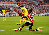 25th September 2021; Brentford Community Stadium, London, England; Premier League Football Brentford versus Liverpool; Ivan Toney of Brentford challenges Curtis Jones of Liverpool