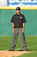 Umpire Takahito Matsuda handles the calls on the bases during the South Atlantic League game between the Asheville Tourists and the Hickory Crawdads at L.P. Frans Stadium on April 13, 2014 in Hickory, North Carolina.  The Tourists defeated the Crawdads 5-4.  (Brian Westerholt/Four Seam Images)