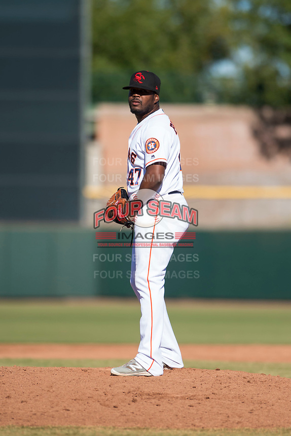 Scottsdale Scorpions relief pitcher Erasmo Pinales (47), of the Houston Astros organization, gets ready to deliver a pitch during an Arizona Fall League game against the Surprise Saguaros at Scottsdale Stadium on October 26, 2018 in Scottsdale, Arizona. Surprise defeated Scottsdale 3-1. (Zachary Lucy/Four Seam Images)