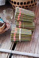 Myanmar, Burma.  Cheroots Made by Intha Women, Inle Lake, Shan State.  Corn husks are used as filters, cordia dichotoma leaves used to wrap the tobacco.