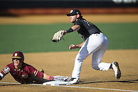 Taylor Walls (10) of the Florida State Seminoles and Wake Forest Demon Deacons third baseman Will Craig (22) look to the umpire for the call at David F. Couch Ballpark on April 16, 2016 in Winston-Salem, North Carolina.  The Seminoles defeated the Demon Deacons 13-8.  (Brian Westerholt/Four Seam Images)