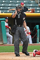 Home plate umpire Alberto Ruiz in action as the Memphis Redbirds played the Salt Lake Bees in Pacific Coast League action at Smith's Ballpark on June 18, 2014 in Salt Lake City, Utah.  (Stephen Smith/Four Seam Images)