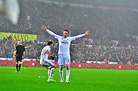 Pictured: Friday 26 December 2014<br /> Re: Premier League, Swansea City FC v Aston Villa at the Liberty Stadium, Swansea, south Wales, UK.<br /> <br /> Swansea's Gylfi Sigurddson celebrates his goal
