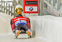 5 December 2014: Kristaps Maurins, sliding for Latvia, crosses the finish line on his first run, ending the day with a 21st place finish and a combined 2-run time of 1:44.530 in the Men's Competition at the Viessmann Luge World Cup, at the Olympic Sports Track in Lake Placid, New York, USA. Mandatory Credit: Ed Wolfstein Photo *** RAW (NEF) Image File Available ***