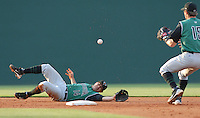 Shortstop Juan Martinez (14) of the Augusta GreenJackets grabs a grounder and tosses to second baseman Ryan Cavan (15) to start a double play during Spartanburg Night with the Greenville Drive on June 8, 2010, at Fluor Field at the West End in Greenville, S.C. Photo by: Tom Priddy/Four Seam Images