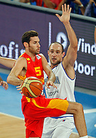 Rudy Fernandez of Spain (L) and Marco Cusin of Italy in action during European basketball championship Eurobasket 2013, round 2, group F  basketball game between Italy and Spain in Stozice Arena in Ljubljana, Slovenia, on September 16. 2013. (credit: Pedja Milosavljevic  / thepedja@gmail.com / +381641260959)