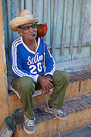 Cuba, Trinidad.  Local Resident with his Pet Hen.