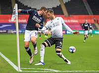 3rd October 2020; Liberty Stadium, Swansea, Glamorgan, Wales; English Football League Championship, Swansea City versus Millwall; Tom Bradshaw of Millwall back heels the ball to a teammate despite the pressure from Joe Rodon of Swansea City