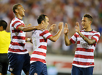 Jacksonville, FL - Saturday, May 26, 2012: Landon Donovan is congratulated by Fabian Johnson, right, and Terrance Boyd, left, after scoring a goal as the USMNT defeated Scotland 5-1 during an international friendly match.