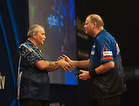 03.01.2015.  London, England.  William Hill PDC World Darts Championship.  Semi Final Round.   Raymond van Barneveld (14) [NED] congratulates Phil Taylor (2) [ENG] after the winning double in their match.  Phil Taylor won the match 6-2