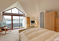 BNPS.co.uk (01202) 558833. <br /> Pic: LillicrapChilcott/BNPS<br /> <br /> Pictured: Bedroom. <br /> <br /> An impressive waterfront home with panoramic views over one of Britain's most popular estuaries is on the market for £2.75m.<br /> <br /> Tregytreath is the perfect property for boat lovers, with access to the foreshore and its own private jetty onto the water.<br /> <br /> The five-bedroom house is in Restronguet Point, one of the most exclusive waterside locations in Cornwall, and this property has one of the most outstanding positions among those prestigious homes.<br /> <br /> The house was designed and built, by the current owners 20 years ago, to make the most of the beautiful views.