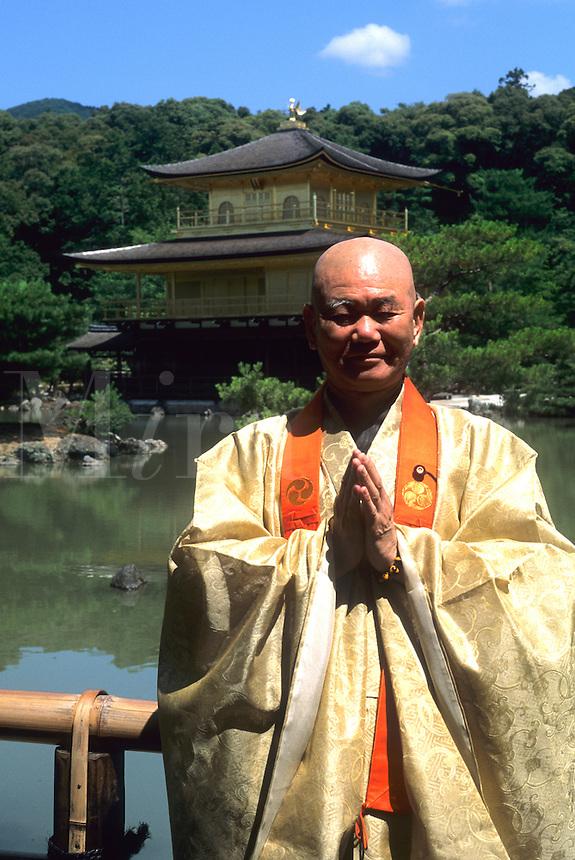 Priest Golden Pavilion at Kinkakuji Temple in Kyoto Japan