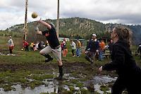 Amos Walkington from Sandpoint, ID at the 2011 Mud Volleyball Tournament in Laclede, ID sponsored by the Kodiak Bar. .(©Matt Mills McKnight/2011)