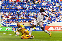 El Salvador goalkeeper Dagoberto Portillo (1) makes a stop on Trinidad and Tobago forward Kenwyne Jones (9) during a CONCACAF Gold Cup group B match at Red Bull Arena in Harrison, NJ, on July 8, 2013.