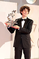 """VENICE, ITALY - SEPTEMBER 11: Filippo Scotti poses with the Marcello Mastroianni Award for Best New Young Actor for """"The Hand Of God"""" at the awards winner photocall d during the 78th Venice International Film Festival on September 11, 2021 in Venice, Italy."""