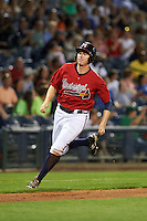 Mississippi Braves outfielder David Rohm (24) scores a run during a game against the Pensacola Blue Wahoos on May 28, 2015 at Trustmark Park in Pearl, Mississippi.  Mississippi defeated Pensacola 4-2.  (Mike Janes/Four Seam Images)