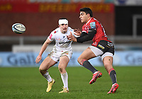26th March 2021; Kingsholm Stadium, Gloucester, Gloucestershire, England; English Premiership Rugby, Gloucester versus Exeter Chiefs; Santiago Carreras of Gloucester passes under pressure from Dan John of Exeter Chiefs