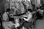 Mother and child playing Bingo in an amusement arcade. Multicultural Britain Notting Hill, Portobello Road west London.