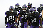 TCU Horned Frogs safety Zach Jackson (21),TCU Horned Frogs defensive end Josh Carraway (35) and TCU Horned Frogs wide receiver David Porter (14) in action before the game between the Oklahoma Sooners and the TCU Horned Frogs  at the Amon G. Carter Stadium in Fort Worth, Texas. OU defeats TCU 24 to 17.