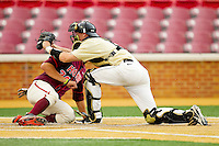 Wake Forest Demon Deacons catcher Brett Armour #6 tags out Brendon Hayden #34 of the Virginia Tech Hokies as he tries to score at Wake Forest Baseball Park on April 21, 2012 in Winston-Salem, North Carolina.  The Demon Deacons defeated the Hokies 8-6.  (Brian Westerholt/Four Seam Images)