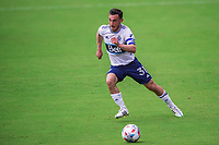 ORLANDO, FL - APRIL 24: Russell Teibert #31 of Vancouver Whitecaps dribbles the ball during a game between Vancouver Whitecaps and Toronto FC at Exploria Stadium on April 24, 2021 in Orlando, Florida.