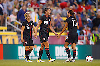 14 MAY 2011: USA Women's National Team midfielder Lori Lindsey (16), forward Abby Wambach (20) and forward Alex Morgan (13) after  the International Friendly soccer match between Japan WNT vs USA WNT at Crew Stadium in Columbus, Ohio.