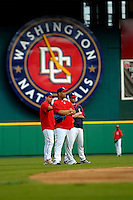 3 September 2005: Livan Hernandez (center), Jose Vidro (left) and Brian Schneider (right) watch infield activities of the Washington Nationals, prior to a game against the Philadelphia Phillies. The Nationals defeated the Phillies 5-4 at RFK Stadium in Washington, DC. <br />