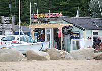 BNPS.co.uk (01202) 558833. <br /> Pic: BNPS<br /> <br /> Pictured: Harbour's Edge Beach Cafe and Watersports by the beach at Rockley Point in Poole Harbour, Dorset. <br /> <br /> There are fresh calls for a holiday park to increase safety measures at a notorious beach where one swimmer has drowned and almost 20 children rescued this summer. <br /> <br /> In the latest incident a dad and his two young sons were plucked to safety in the nick of time after they were swept away by a rip tide at Rockley Park in Poole Harbour, Dorset.<br /> <br /> It happened a month after hero swimmer Callum Baker-Osborne, 18, drowned while helping to rescue 13 children at the same spot.<br /> <br /> And before that two young girls were saved from drowning by a paddleboarder.