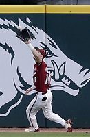 Arkansas infielder Matt Goodheart (10) forces an out, Saturday, June 5, 2021 during the first inning in the second game of the NCAA Fayetteville Regional at Baum-Walker Stadium in Fayetteville. Check out nwaonline.com/210606Daily/ for today's photo gallery. <br /> (NWA Democrat-Gazette/Charlie Kaijo)