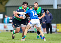 Saturday 10th October 2020 | Ballynahinch vs Queens<br /> <br /> Nacho Caldera is tackled by Graham Curtis during the Energia Community Series clash between Ballynahinch and Queens at Ballymacarn Park, Ballynahinch, County Down, Northern Ireland. Photo by John Dickson / Dicksondigital