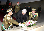 Palestinian president lays a floral wreath on the former Palestinian leader grave Yasser Arafat, on the eve of the 48th anniversary of the formation on the Fatah movement, on December 31, 2012, in the West Bank city of Ramallah. The Fatah anniversary commemorates the first operation against Israel claimed by its armed  wing then known as Al-Assifa (The Thunderstorm in Arabic) on January 1, 1965. Photo by Thaer Ganaim
