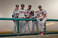 Tri-City ValleyCats Shea Barry (26), Juan Paulino (16), manager Ozney Guillen (13), Luis Santana (7), and Deury Carrasco (23) pose for a photo in a fog delay during a NY-Penn League game against the Brooklyn Cyclones on August 17, 2019 at MCU Park in Brooklyn, New York.  Brooklyn defeated Tri-City 2-1.  (Mike Janes/Four Seam Images)