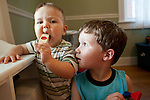 My son, right, almost four, watches his brother, left, age one, play the kazoo.