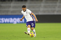ORLANDO CITY, FL - JANUARY 31: Cristian Roldan #15 of the United States passes off the ball during a game between Trinidad and Tobago and USMNT at Exploria stadium on January 31, 2021 in Orlando City, Florida.