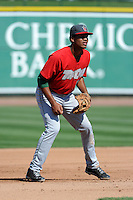 Fort Wayne TinCaps third baseman Gabriel Quintana (15) during a game against the Great Lakes Loons on August 18, 2013 at Dow Diamond in Midland, Michigan.  Fort Wayne defeated Great Lakes 4-3.  (Mike Janes/Four Seam Images)