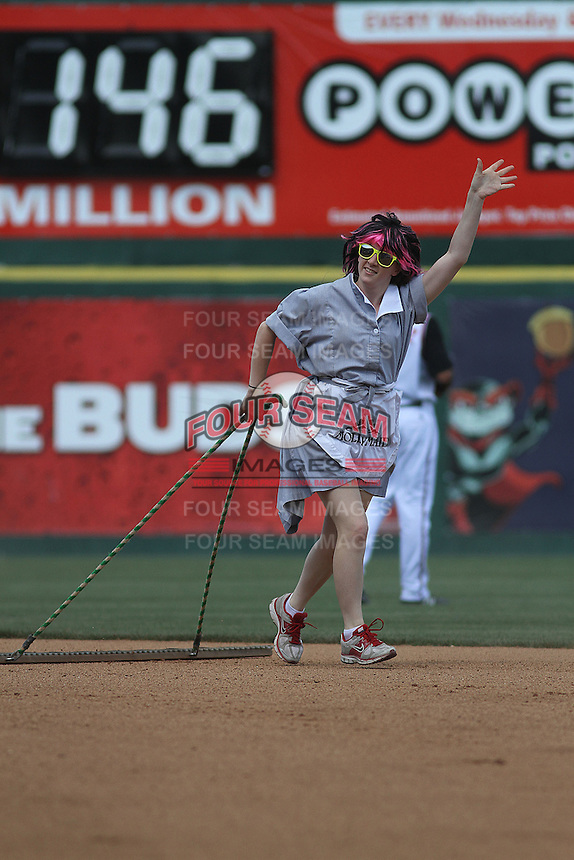 """One of the """"Molly Maid Drag Queens """" dragging the field between innings in a game between the Richmond Flying Squirrels and the Trenton Thunder at The Diamond on May 27, 2012 in Richmond, Virginia. Richmond defeated Trenton by the score of 5-2. (Robert Gurganus/Four Seam Images)"""