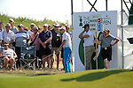 Philip Golding of England plays his shot alongside spectators on the side of 9th green during day one of The Senior Open Golf Tournament at The Royal Porthcawl Golf Club in South Wales this afternoon.