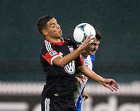 Luis Silva (12) of D.C. United fights for the ball with Matt Kassel (8) of the Philadelphia Union during a Major League Soccer game at RFK Stadium in Washington, DC. D.C. United tied the Philadelphia Union, 1-1.