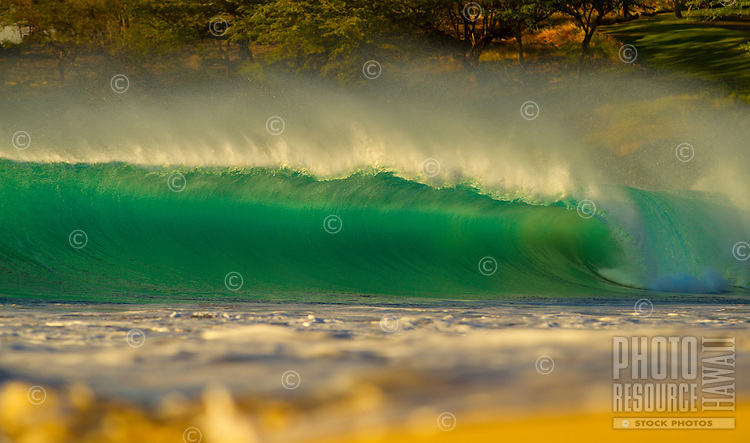 An uncrowded big green barrel wave cresting at a rarely empty Hapuna Beach State Park, Big Island.