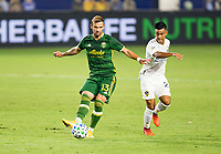 CARSON, CA - OCTOBER 07: Dario Zuparic #13 of the Portland Timbers passes off the ball during a game between Portland Timbers and Los Angeles Galaxy at Dignity Heath Sports Park on October 07, 2020 in Carson, California.