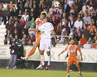 Brad Rusin 324 Of the Carolina Railhawks heads over Marco Velez #4 of the Puerto Rico Islanders during the second leg of the USSF-D2 championship match at WakeMed Soccer Park, in Cary, North Carolina on October 30 2010. The game ended 1-1, Puerto Rico won on overall goals 3-1.