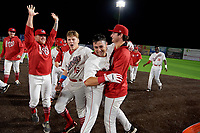 Auburn Doubledays Trey Turner (left), Jake Randa (16), and Tyler Dyson (right) celebrate with Jake Alu (9) after a game winning walk off single during a NY-Penn League game against the Mahoning Valley Scrappers on August 27, 2019 at Falcon Park in Auburn, New York.  Auburn defeated Mahoning Valley 3-2 in ten innings.  (Mike Janes/Four Seam Images)
