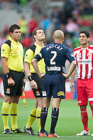 MELBOURNE, AUSTRALIA - DECEMBER 11: The captains and the referee watch the coin toss at the round 18 A-League match between the Melbourne Heart and Melbourne Victory at AAMI Park on December 11, 2010 in Melbourne, Australia. (Photo by Sydney Low / Asterisk Images)