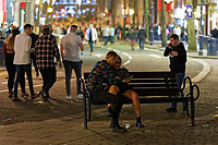 Pictured: A young couple rest on a bench in Swansea. Tuesday 31 December 2019 to Wednesday 01 January 2020<br /> Re: Revellers on a night out for New Year's Eve in Wind Street, Swansea, Wales, UK.