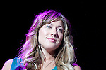 """Colbie Caillat looks out over the audience as she performs her hit song """"Bubbly"""" during the 10th Annual Jingle Bell Bash at the Tacoma Dome in Tacoma, WA., on December 4, 2007.  Jim Bryant Photo. ©2007. All Rights Reserved."""