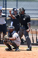 Umpire Edwin Moscoso makes a call behind catcher Carlos Martinez during the first game of a doubleheader between the GCL Braves and GCL Yankees 1 on July 1, 2014 at the Yankees Minor League Complex in Tampa, Florida.  GCL Yankees 1 defeated the GCL Braves 7-1.  (Mike Janes/Four Seam Images)