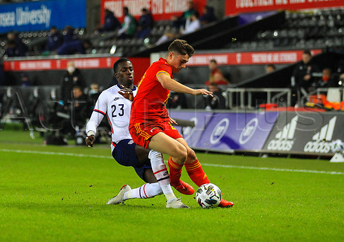 12th November 2020; Liberty Stadium, Swansea, Glamorgan, Wales; International Football Friendly; Wales versus United States of America; Daniel James of Wales is tackled by Tim Weah of USA